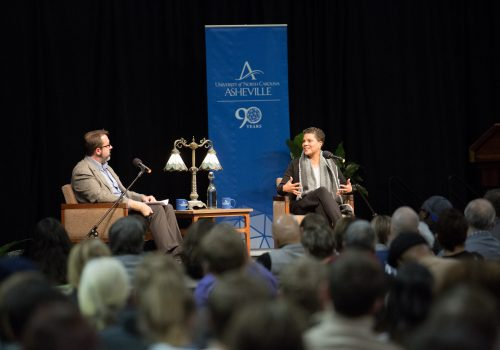 Michelle Alexander on stage with Professor of Math Patrick Bahls