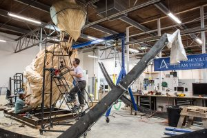 Brent Skidmore working on a giant sculpture in STEAM Studio