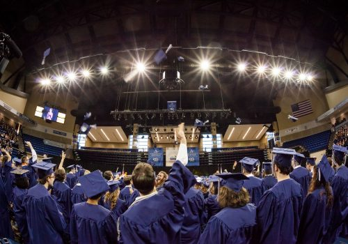 Hat toss from behind the graduates in Kimmel Arena