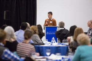 UNC Asheville student Melchor Gamez speaks at the luncheon