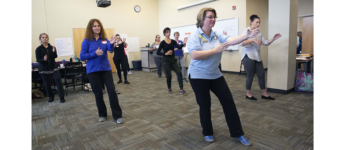 Meghan Bryant led the Tai Chi for Arthritis and Fall Prevention workshop at UNC Asheville. Janice DeMille (dark blue shirt) will teach the class in Marion.