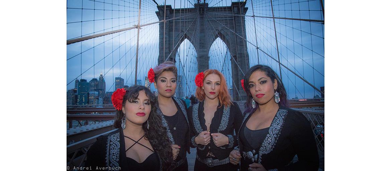 Flor de Toloache band members pose on the Brooklyn Bridge