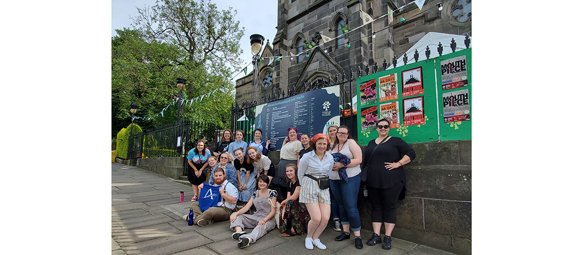 UNC Asheville students and faculty pose outside of the Greenside Parish Church in Edinburgh, Scotland, where they are performing four shows as part of the famed Festival Fringe.