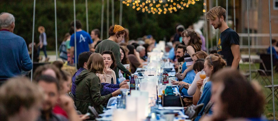 People eating at the Farm to Table dinner.