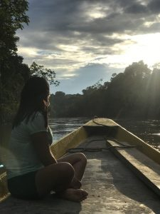 a woman on a boat in a river