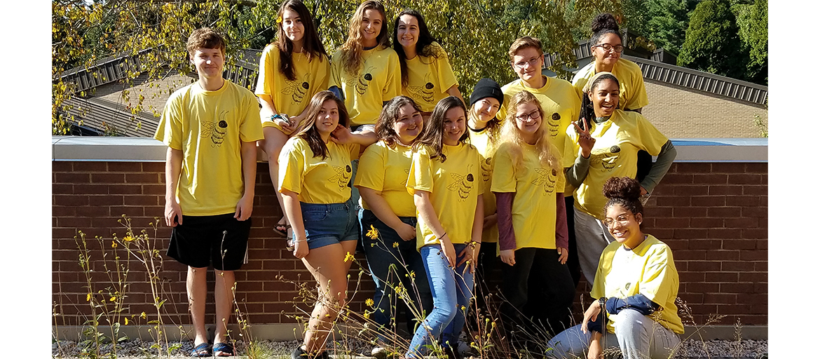 a group photo of students in yellow honeybee shirts