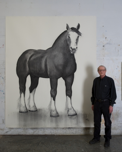 William Beckman posed next to his large drawing of a Clydesdale horse