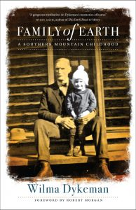 """Book cover of """"Family of Earth"""" has photo of older man and young child and endorsement quote from Wiley Cash"""