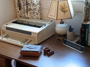 desk has Dykeman's typewriter and other items
