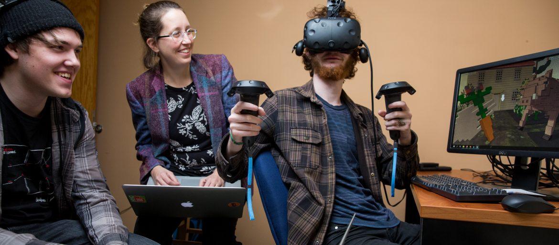 Victoria Bradbury working with student wearing VR headset