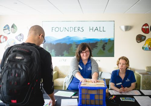 Student checking in at Founders Hall on move in day