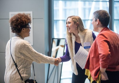 Student shaking hands with an alumna at a UNC Asheville Career Center fair