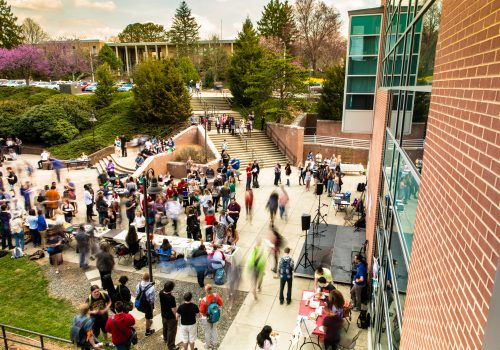 Overview shot of a crowd of students in front of Highsmith Union on Languages in Action Day