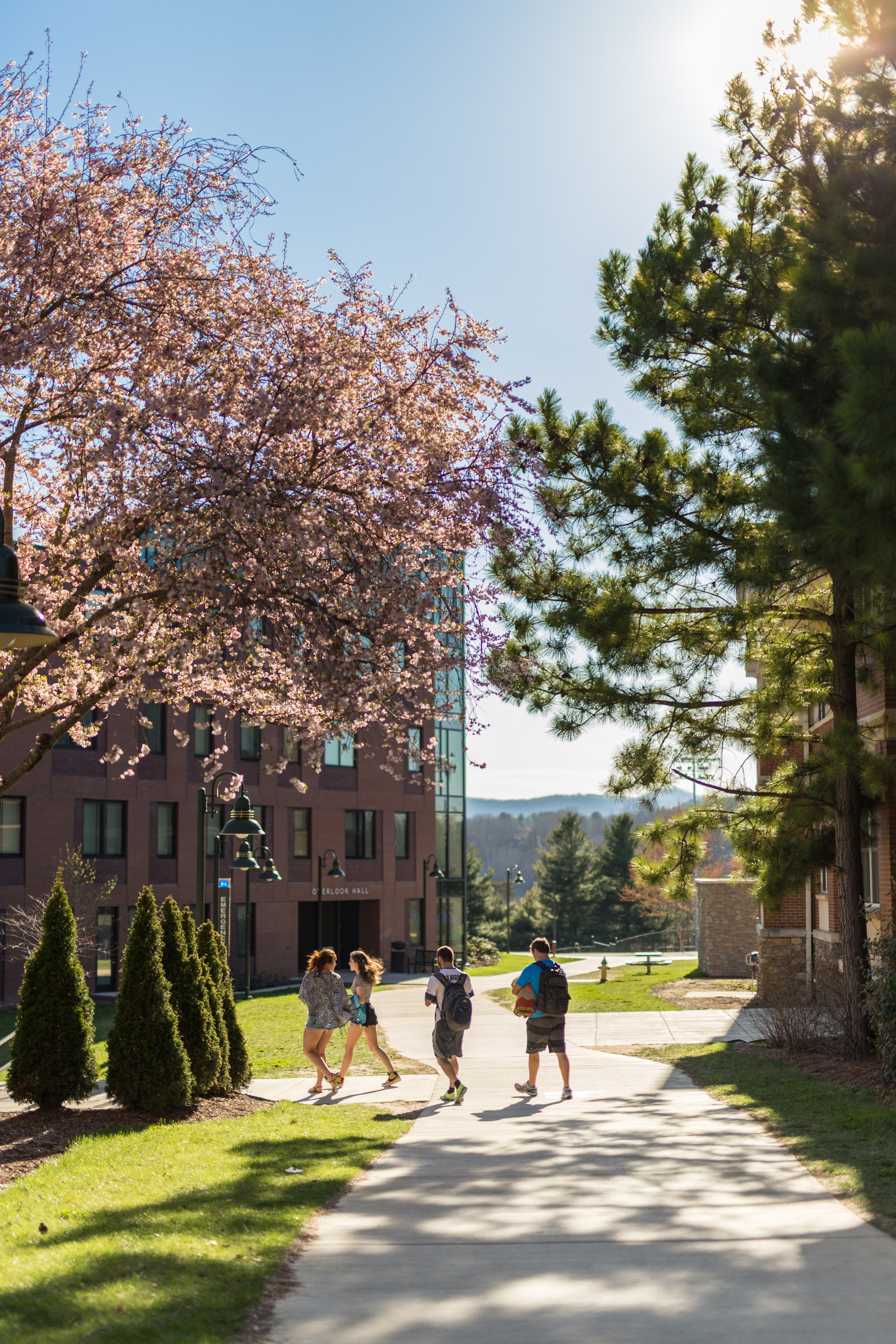 Students walking by Ponder Hall in the spring